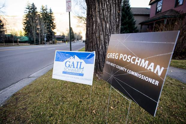 Signs supporting candidates Gail Schwartz for Congress and Greg Poschman for County Commisioner, for the upcoming election line a yard in Aspen.