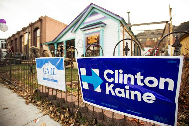 Campaign signs supporting Hillary Clinton and Gail Schwartz on Main Street.