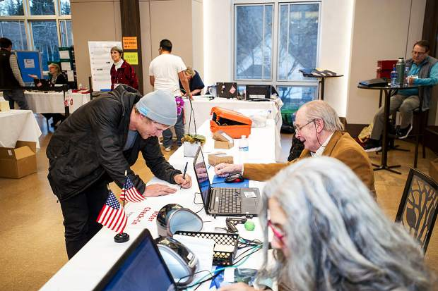 Chase Demeulenaere at the voter check in table at the Aspen Jewish Community Center on Tuesday evening.