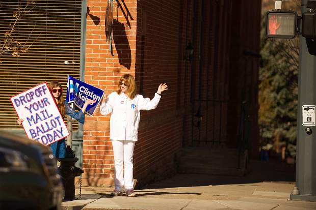 A mother and daughter campagin for Hillary on Mill and Main Street on Tuesday.
