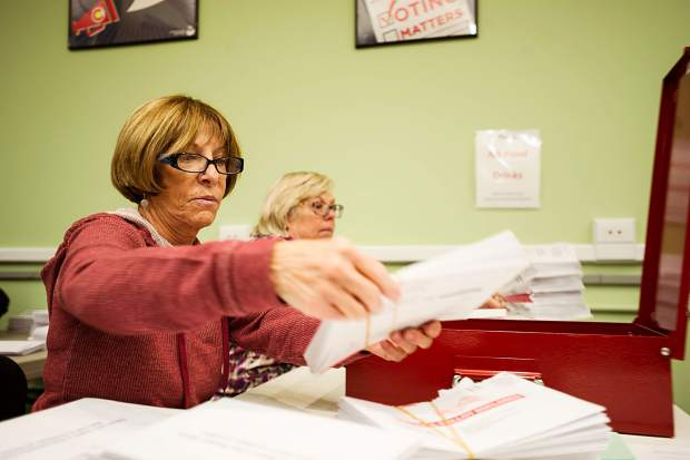 Ellen Marshall, left, and Debe Nelson aid in the ballot counting process on Tuesday.