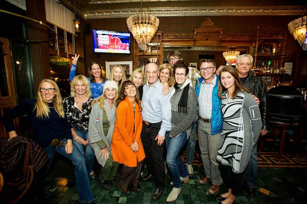 Newly elected County Commissioner Greg Poschman celebrates at J-Bar with friends and family Tuesday night.