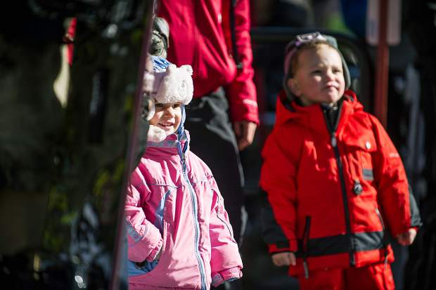 A brother and sister wait for the gondola on Fanny Hill in Snowmass for their opening day on Thursday.