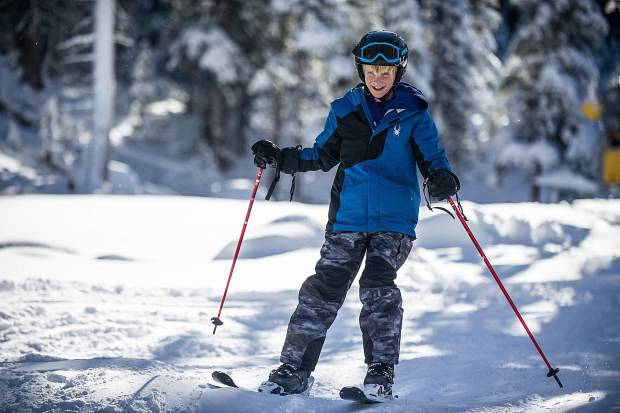 A skier enjoys skiing in the Meadows at Snowmass on opening day this Thursday.