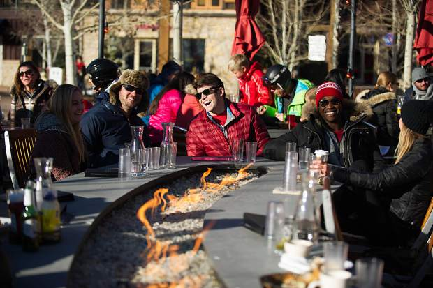 From right to left Mel Stout, Quincy Landingham, Scott Madsen, CJ Marck, and Ellie Stout enjoy an apres ski beers at the Base Camp Bar and Grill in Snowmass on Thursday.