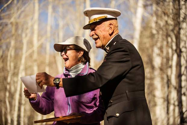 Liz Schultze accepts and honorary Marine certificate from LtCol Dick Merritt at Thursday's birthday celebration for the U.S. Marine Corps at Aspen Grove Cemetery.