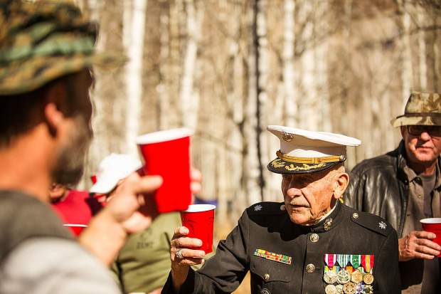 LtCol Dick Merritt makes a toast at Thursday's birthday celebration for the U.S. Marine Corps at Aspen Grove Cemetery.
