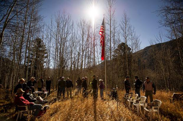 People gather to celebrate the Marine Corps. birthday at the Aspen Grove Cemetary on Thursday. They also admitted an honorary Marine Corps. member at the celebration.
