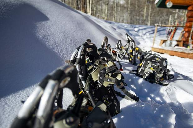 Snowshoes set out for future naturalists for the Aspen Center for Environmental Studies and Jim Kravitz, the ACES Naturalist Program Director, for training Wednesday morning at King's Cabin in Ashcroft.