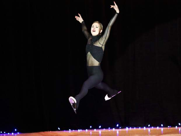 Ashley Cain gets air during a solo routine Saturday at the Aspen Ice Spectacular at Lewis Ice Arena.