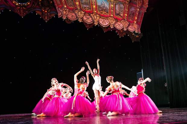 The flower characters dance with soloist Jenelle Figgins, center, for the Aspen Santa Fe Ballet dress rehearsal of the Nutcracker at the Aspen District Theatre Wednesday afternoon.