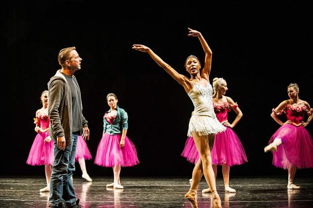 Soloist Jenelle Figgins of the Aspen Santa Fe Ballet gets critiqued by artistic director Tom Mossbrucker on Wednesday afternoon at the dress rehearsal for the Nutcracker at the Aspen District Theatre.