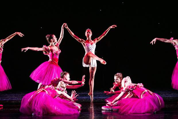 The flower characters dance with soloist Jenelle Figgins, center, as character Dew Drop for the Aspen Santa Fe Ballet dress rehearsal of the Nutcracker at the Aspen District Theatre Wednesday afternoon.