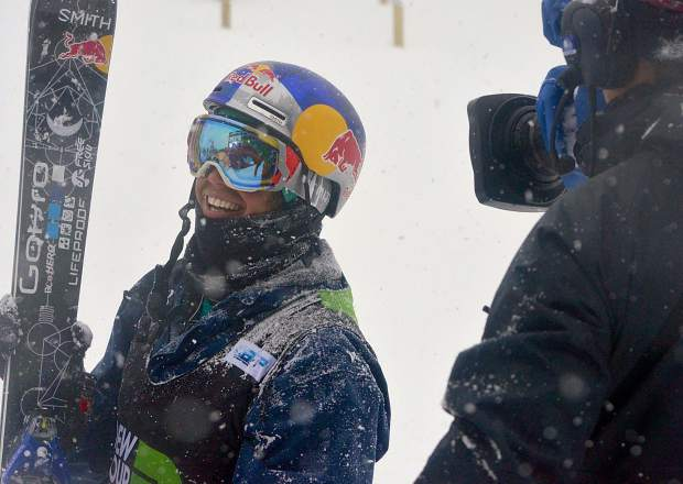 Scenes from snowboard and freeski slopestyle jib finals at Dew Tour on Saturday. The day started clear and blustery before another round of snow blew into Breckenridge. Bobby Brown from Breckenridge takes a pause from the action.