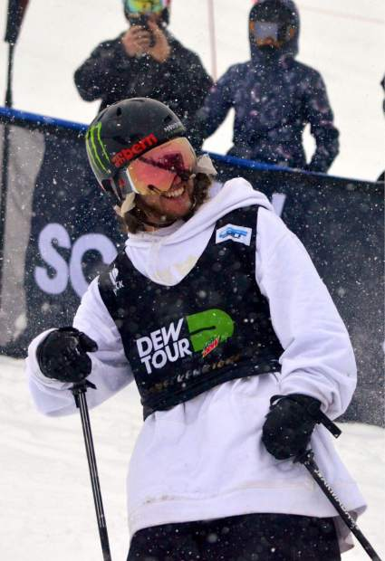 Scenes from snowboard and freeski slopestyle jib finals at Dew Tour on Saturday. The day started clear and blustery before another round of snow blew into Breckenridge. Henrik Harlaut smiles as he passes by.