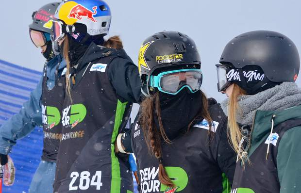 Breckenridge local Keri Herman (second from right) chats with fellow competitors while waiting for a snowmobile for practice laps before the women's ski slopestyle jump finals on Friday. Herman ended the day in 10th overall.
