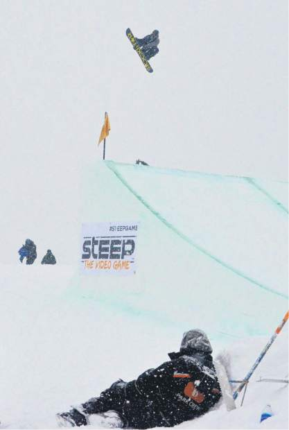 American snowboarder Chas Guldemond spins a double 1260 during the men's snowboard slopestyle jump finals for Dew Tour at Breckenridge on Friday, Dec. 9. Guldemond, a past Dew Tour slopestyle champion, ended the day in sixth overall.