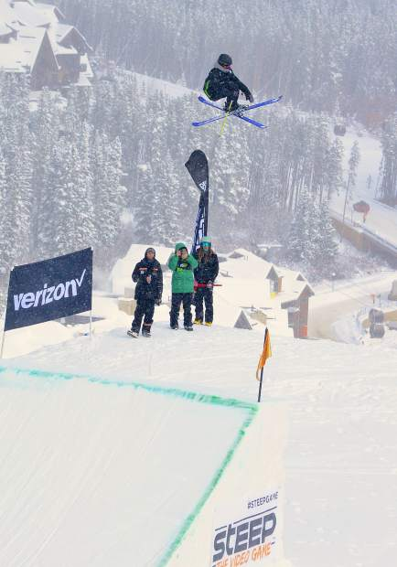 A skier in the women's ski slopestyle jump finals at Dew Tour spins off the big-air jump at Peak 8 on Friday morning.
