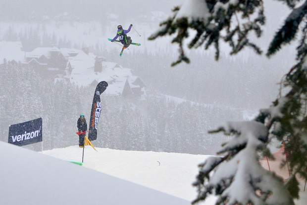 A skier tweaks a tail grab with a 720 during the women's ski slopestyle jump finals at Dew Tour in Breckenridge on Friday morning.