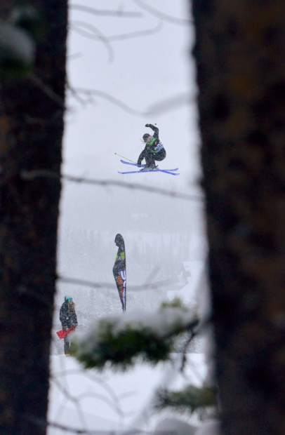 A skier spins a 720 during the women's ski slopestyle jump finals at Dew Tour on Friday morning.