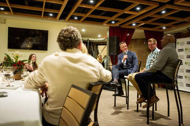 Chris Klug, left, speaks with transplant recipients and Bounce Back Award winners Christopher Nalley,center, and Donerik Black at the Summit for Life Battle of the Chefs event at the Aspen Cooking Cooking School Friday night.