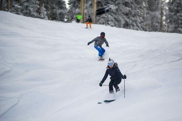 Skiers and snowboarders enjoy the fresh powder on Gent's Ridge on Aspen Mountain on Friday.