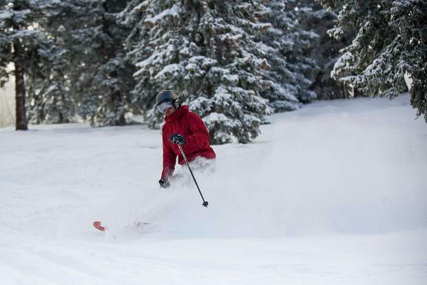 Local Justin Barker enjoys fresh powder on Glade 3 on Aspen Mountain on Friday.