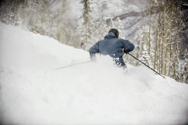 Sam Augustine enjoys the fresh snow on the back of Bell on Aspen Mountain on Wednesday.
