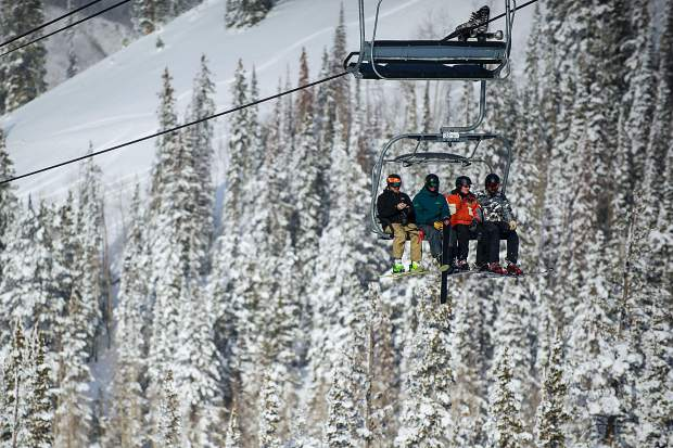 Skiers head up Ajax Lift on Aspen Mountain Thursday afternoon.