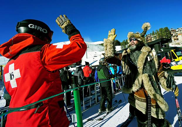 Ullr offers a high-five to ski patrol at Breckenridge opening day this season. Before the holiday rush, patrollers at Breck and Keystone gave tips for proper ski area etiquette, including one simple rule — just be kind.