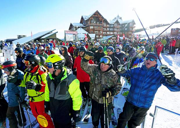 Skiers and snowboarders cheer before the first chair of the 2015-16 ski season at Breckenridge on Friday, Nov. 13. A new economic impact study says the winter-driven industry infuses almost $5 billion into the state's economy.