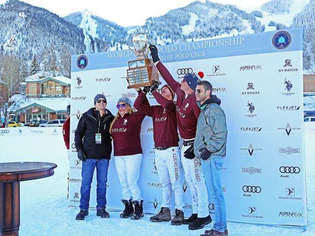 Team Flexjet gets pictures with the trophy Sunday after winning the 2016 World Snow Polo Championship in Aspen.