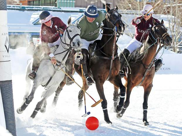 Flexjet's Jesse Bray, left, and Melissa Ganzi, right, battle with U.S. Polo Assn. player Tommy Biddle during Sunday's finale of the 2016 World Snow Polo Championship at Rio Grande Park in Aspen. Flexjet won the game, 7-4.