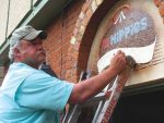 File photo Artist Gaard Moses does artwork on the sign at Two Old Hippies, the former counter-culture shop in Aspen. Moses said that in his 50 years of doing commercial artwork in Aspen, the defunct Nello Alpine Aspen restaurant was his most difficult client when it came to paying bills, leaving him holding the bag for his work and labor expenses.