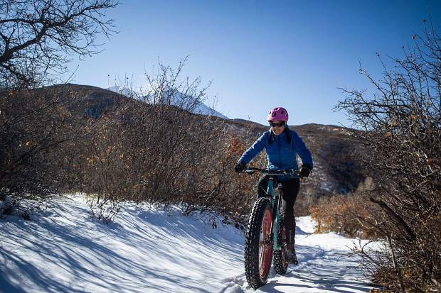 Rebecca Murray rides her fat bike on the Prince Creek Trails in Carbondale on Thursday.
