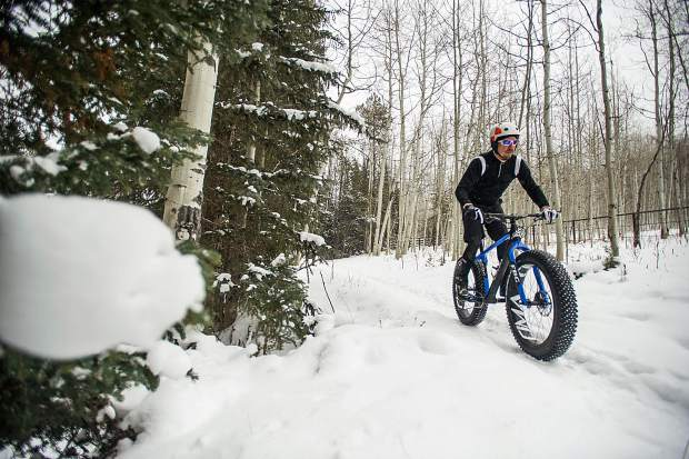 Ute City Cycles' owner Bubba Scott rides his CIMA fatbike on the Hunter Creek Trails in Aspen on Friday.