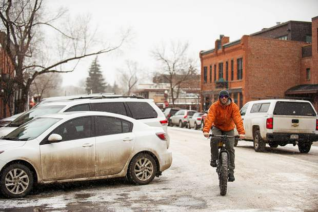 Drew Copps makes his deliveries for the restaurant Big Wrap on a fat bike on Friday in Aspen.