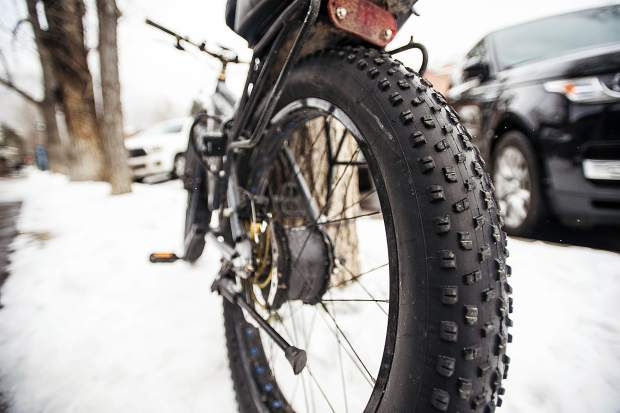 Fat bike tires' width and tread are much larger to gain traction on surfaces such as snow and sand.  Ute City Cycles' owner Bubba Scott says a good psi level is 6 when riding in the winter.