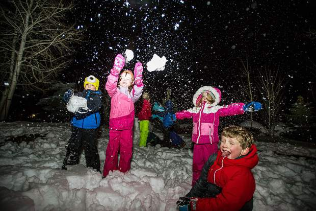 Right to left, Anderson Tippet, 5, Ellis Burggraf, 4.5, Violet Striegler, 4, Sam Striegler, 5, throw snow in the air at the Light Up the Night celebration at the Snowmass Chapel on Dec. 10.