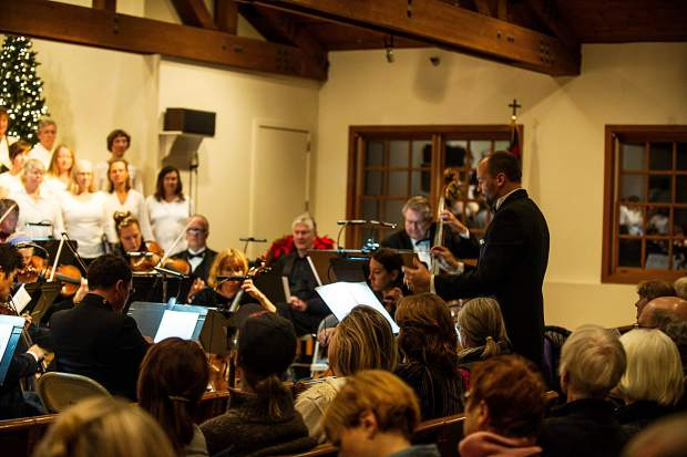 Director Paul Dankers conducting the Messiah choral performance at the Snowmass Chapel on Saturday, December 10.
