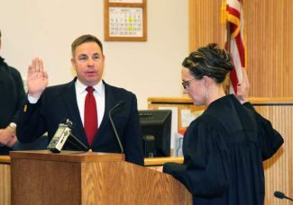 Jeff Cheney, left, is sworn in as the 9th Judicial District Attorney Tuesday afternoon by Judge Anne Norrdin.