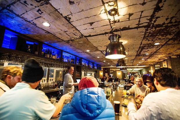 Patrons enjoy hanging out at Aspen's The Grey Lady on the night of December 29.