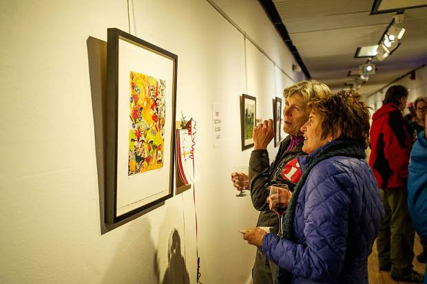 Basalt resident Sandy Kucharczyk, right, and Aspen resident Cheri Grinnell, admire local artist Isa Catto's