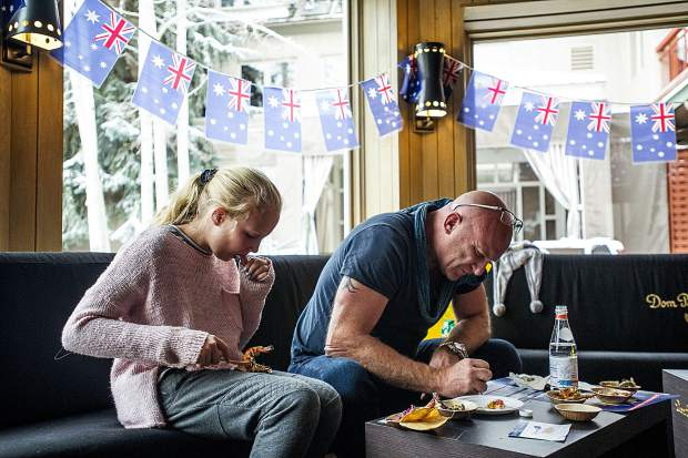 "Australian Celebrity Chef Matt Moran, right, marks the scores for each chef's shrimp dish while his daughter Amelia also tries each prawn dish by his side. Moran coronated Nate King of Cache Cache the winner of the 2017 Australian Celebrity Chef Cooking Contest for his most flavorful take on ""Shrimp on the Barbie,"" this year's theme. The invite-only event was hosted by The Little Nell, Aspen Skiing Company and Residences at The Little Nell, inviting chefs from the Aspen Snowmass area to take part in a friendly competition."