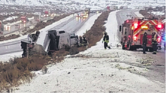 Emergency crews inspect the situation Monday morning after a fuel tanker truck overturned on eastbound Interstate 70 near Dotsero, resulting in a near daylong road closure and detour onto U.S. 6.