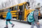 Students get off school bus Wednesday in the West End neighborhood. The Aspen School District removed all seat belts from its largest school buses during the last month and a half, officials said.