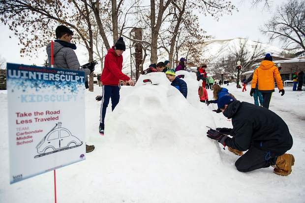 5 middle schools participated in the Winterskol Kids Sculpt competition put on by Anderson Ranch on Friday in Aspen's pedestrian mall. Judging occurred that afternoon by 2 artists from Anderson Ranch. The City of Aspen's Parks and Rec department gathered snow and created 4-square-feet blocks for each team.