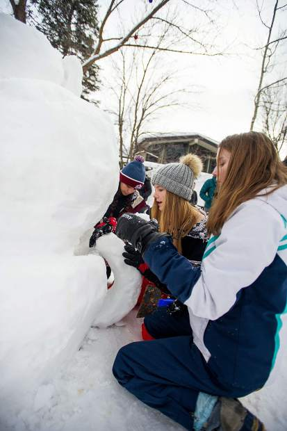 Aspen Country Day school 8th grade students, Houston Kilby, front, Graylin Gogolack, and Maria Hancox work on their snow sculpture design