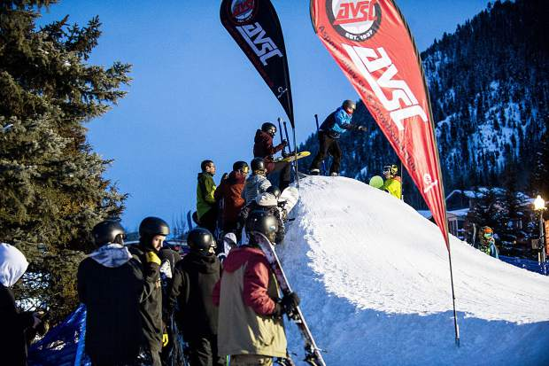 Competitiors line up to take their runs at the Winterskol Aspen Valley Ski and Snowboard Club rail jam in Wagner Park Friday.