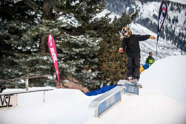 Sheldon Sims one-foot skis on the flat to down rail set up for the Winterskol Aspen Valley Ski and Snowboard Club rail jam in Wagner Park Friday.